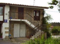 Casa con 2 habitaciones,cocina y ba�o.