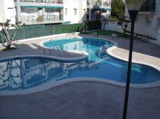 Bajos 2 hab con terraza y piscina
