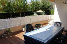 Planta baja con terraza y piscina en zona tranquila