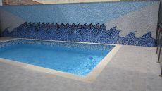 Bonita planta baja con terraza y piscina