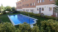 Casa adosada con piscina