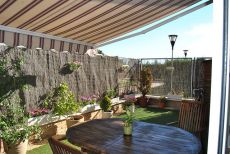 Piso bajo con jardin en urbanizacion privada
